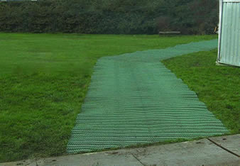The anti-slip grass protection mesh is covering the grassland to from a pedestrian way.