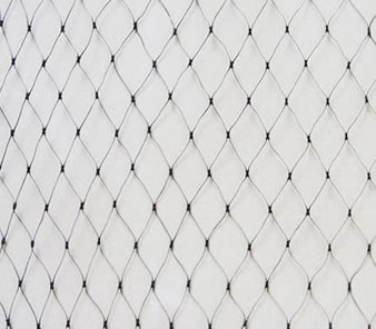 A piece of black diamond extruded bird netting on the white background.