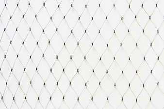 A piece of diamond extruded garden netting on the white background.