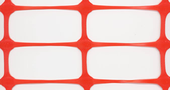 A piece of red rectangular extruded plastic mesh on the white background.