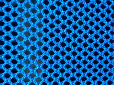 A piece of blue color flexible windbreak netting on the table.