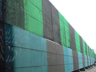 green and black and blue and black flexible windbreak netting is installed on the frame.
