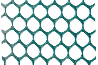 A piece of green hexagonal grass protection mesh on the white background.