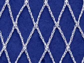 A piece of white knitted garden netting on the blue background.