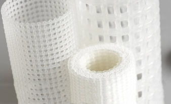 Three different type of extruded plastic netting tube on the gray background.