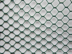 A piece of extruded plastic screen mesh on the floor.
