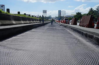 The quaxial plastic geogrid is installed on the paved ground.